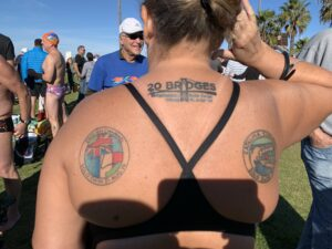 Diana Corbin's Back with tattoos of her three major swims